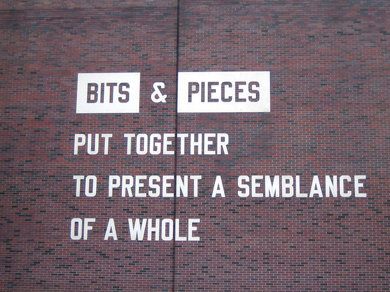 "Photograph of ""Bits & Pieces Put Together To Present A Semblance of a Whole"" by Lawrence Weiner on display at the Walker Art Center in Minneapolis, Minnesota"